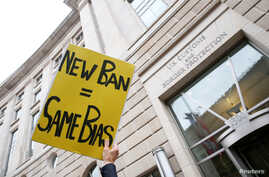 Immigration activists, including members of the DC Justice for Muslims Coalition, rally against the Trump administration's new ban against travelers from six Muslim-majority nations, outside of the U.S. Customs and Border Protection headquarters in W