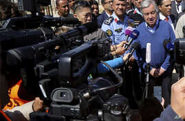 FILE - U.N. Secretary-General Antonio Guterres, right, speaks to journalists during a visit to the U.N.-run Zaatari camp for Syrian refugees, in northern Jordan, March 28, 2017. According to a U.N. report made available April 12, 2017, Guterres wants