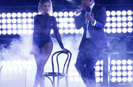 Beyonce and her husband Jay-Z perform at the 56th annual Grammy Awards in Los Angeles, California, Jan. 26, 2014.