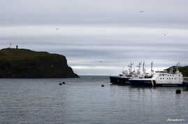 FILE - Russian coast guard ships are moored at the southern Kurile Island of Shikotan, Sept. 14, 2015. Moscow says it will deploy new defense systems and drones to the disputed islands this year.