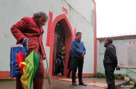Pan Yinbao, a priest for Yingtan with the official church backed by the Beijing-controlled Catholic Patriotic Association, speaks with a faithful outside the church in Yingtan, Jiangxi province, China, March 25, 2018.