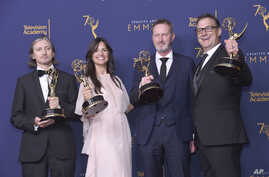 """From left; Ronan Hill, Onnalee Blank, Richard Dyer, and Mathew Waters winners of the award for outstanding sound mixing for a comedy or drama series (one-hour) for """"Game of Thrones - Beyond The Wall"""" pose in the press room during night one of the Cre"""