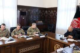 General Mark Milley meets with Afghan President Ashraf Ghani at the presidential palace, Jan. 3, 2019.