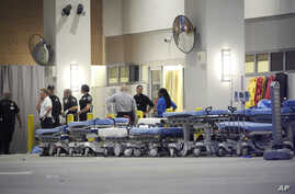 FILE - Emergency personnel wait with stretchers at the emergency entrance to Orlando Regional Medical Center hospital for the arrival of patients from the scene of a fatal shooting at Pulse Orlando nightclub in Orlando, Florida, on June 12, 2016.