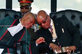 FILE - South African President Jacob Zuma, right, exchanges words with Chief Justice Mogoeng Mogoeng, left, at the inauguration ceremony of Zuma, in Pretoria, May 24, 2014.