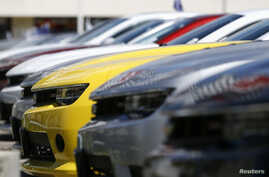 A group of Chevrolet Camaro cars for sale is pictured at a car dealership in Los Angeles, California, April 1, 2014.