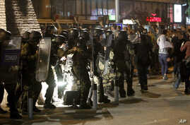 Riot police intervene after a protest turned violent in Skopje, Macedonia, April 13, 2016. Opposition supporters gathered in the capital for a second day to demand the resignation of President Gjorge Ivanov over pardons in a wiretapping probe.
