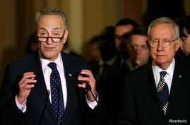 Senate Minority Leader Harry Reid (D-NV) (R) and Senator Chuck Schumer (D-NY) speak with reporters regarding a stop-gap funding bill to avoid a federal government shutdown later this week on Capitol Hill in Washington, Sept. 27, 2016.