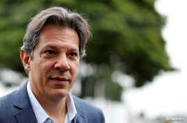 Workers Party vice presidential candidate Fernando Haddad, leaves the Federal Police headquarters, where Brazilian former President Luiz Inacio Lula da Silva is imprisoned, after visiting him, in Curitiba, Brazil, Sept. 3, 2018.