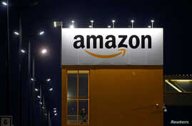 FILE - The logo of Amazon is seen at the company logistics center in Lauwin-Planque, France, Feb. 20, 2017.