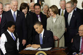 """In this Tuesday, March 23, 2010 file photo, President Barack Obama signs the Affordable Care Act, or """"Obamacare,"""" in the East Room of the White House in Washington, D.C."""