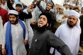 FILE - Pakistanis rally in support of Mumtaz Qadri who was convicted and executed for a blasphemy-motivated killing of a former governor, in Lahore, Pakistan, Feb. 29, 2016.