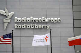 The headquarters of Radio Free Europe/Radio Liberty (RFE/RL) is seen with the United States, RFE/RL and the Czech Republic flags in the foreground, in Prague, January 15, 2010.