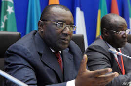 FILE - Governor of the Bank of Central African States (BEAC) Lucas Abaga Nchama (L).