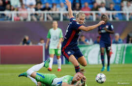 FILE - Olympique Lyonnais faces off against VfL Wolfsburg in the women's Champions League final at Valeriy Lobanovskyi Stadium, Kyiv, Ukraine, May 24, 2018.