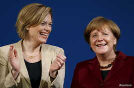 German Chancellor Angela Merkel and Christian Democratic Union (CDU) deputy head and leader of the CDU in the state of Rhineland-Palatinate, Julia Kloeckner (L) attend a CDU party election campaign rally in Landau, Germany, February 22, 2016.