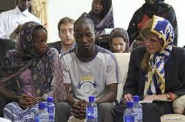 At the Grand Mosque, U.S. Ambassador to the United Nations Samantha Power meets with Ebola survivors Fanta Oulen Camara, 24, left, and Dr. Oulare Bakary, 30, center,  in Conakry, Guinea Oct. 26, 2014.