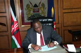 Kenya's President Uhuru Kenyatta invokes article 147(3) of the constitution appointing Deputy President William Ruto as acting President  in a ceremony at his office in the capital Nairobi while he attends the ICC status conference at the Hague, Oct.