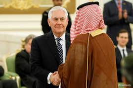 U.S. Secretary of State Rex Tillerson shakes hands with a participant as he attends a signing ceremony between U.S. President Donald Trump and Saudi Arabia's King Salman bin Abdulaziz Al Saud at the Royal Court in Riyadh, May 20, 2017.