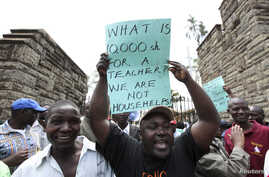 Teachers demonstrate outside Kenya's Parliament Buildings in the capital Nairobi September 7, 2011. Many Kenyan state schools remained closed on Tuesday after thousands of teachers went on strike to try to force the government to increase their numbe