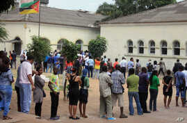 FILE - Voters queue to cast their votes at a polling station, in Maputo, Mozambique,  Wednesday, Oct. 15, 2014.