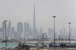 The skyline is seen with the Burj Khalifa as ships dock at Port Rashid, in Dubai, May 26, 2013.