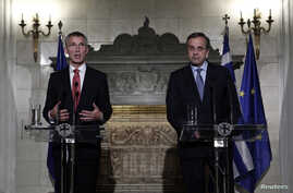 NATO Secretary General Jens Stoltenberg (L) addresses journalists alongside Greece's Prime Minister Antonis Samaras during a news conference following their meeting in Athens, Oct. 30, 2014.
