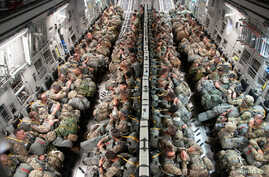 FILE - Soldiers from the Texas Army National Guard, 1-141 Infantry Battalion, are transported to Miroslawiec Air Base, Poland on a C-17 Globemaster III during exercise Swift Response 18 on June 8, 2018.  (U.S. Air National Guard/Senior Airman John Li
