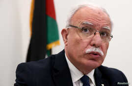 FILE - Palestinian Foreign Minister Riyad al-Maliki holds a news conference at the International Criminal Court in The Hague, Netherlands, May 22, 2018.
