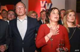 Members of the ruling People's Party for Freedom and Democracy (VVD) react during the Dutch general elections in The Hague on March 15, 2017.