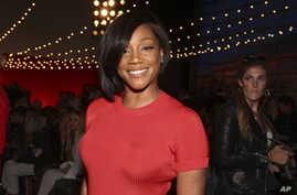 FILE - Tiffany Haddish attends the NYFW Spring/Summer 2019 Brandon Maxwell fashion show at Classic Car Club Manhattan in New York, Sept. 8, 2018. Tiffany Haddish is continuing her hot streak, winning an Emmy Award in her first try.