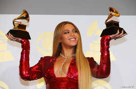 FILE - Beyonce shows off the awards she won for Best Urban Contemporary Album for 'Lemonade' and Best Music Video for 'Formation' at the 59th Annual Grammy Awards in Los Angeles, California, U.S. , Feb. 12, 2017.