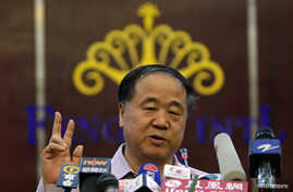 Chinese writer Mo Yan gestures during a news conference in his hometown of Gaomi, Shandong province October 12, 2012.