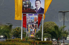 Billboards showing presidents of Azerbiajan, Kazakhstan and Turkey on a main highway to welcome them in Islamabad, Pakistan, Feb. 28, 2017.