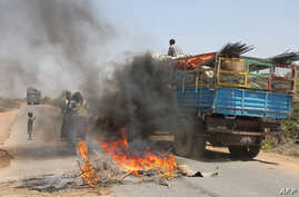A truck passing a partial roadblock setup by residents as a protest against the Islamist Al-Shabab insurgent group, in Tobanka Buundo in the lower Shabelle region, near the Somalian capital Mogadishu, March 6, 2014.