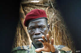 Lord's Resistance Army (LRA) commander Caesar Acellam gestures as he talks to the media after he was captured by Ugandan soldiers tracking  LRA fugitive leaders at a forest bordering the Central African Republic and the Democratic Republic of Congo,