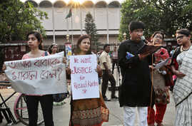 FILE - Bangladeshi teachers, students and social activists hold banners and sing songs during a protest against the killing of a university professor, A.F.M. Rezaul Karim Siddique, in Dhaka, April 29, 2016. Siddique was hacked to death on his way to