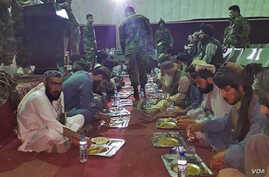 Prisoners freed from Taliban prisons in Helmand dine at an Afghan military facility. (MOD)