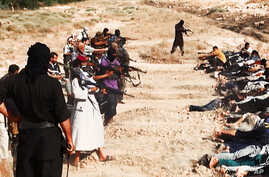 This image, posted on a militant website and which appears to show ISIL militants taking aim at captured Iraqi soldiers, has been verified and is consistent with other AP reporting and was confirmed by Iraq's top military spokesman, June 15, 2014.