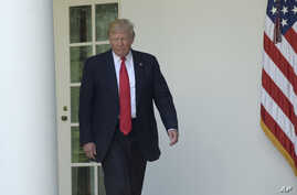 President Donald Trump walks out of the Oval Office into the Rose Garden of the White House in Washington, June 1, 2017. Republican lawmakers have begun to press Trump on whether tapes exist from his conversations with since fired FBI director James