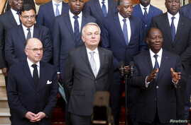 French Interior Minister Bernard Cazeneuve (L), French Foreign Minister Jean-Marc Ayrault (C) and Ivory Coast President Alassane Ouattara (R) are seen during a press conference at presidential palace in Abidjan, Ivory Coast, March 15, 2016.