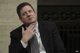 Chicago police Officer Jason Van Dyke listens while attorneys step before Judge Vincent Gaughan bench, as the jury has sent another question to Judge Gaughan, who read it aloud from the bench during deliberations in Van Dyke's trial at the Leighton C