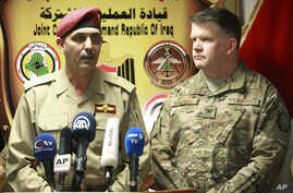 Gen. Yahya Rasool, left, an Iraqi military spokesman, speaks during a press conference with Col. John Dorrian, a U.S. spokesman for the coalition, in Baghdad, April 11, 2017.