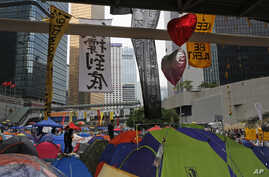 Tents are set up at the occupied areas by the pro-democracy protesters outside the government headquarters in Hong Kong's Admiralty, Oct. 26, 2014.