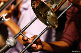 A musician plays a trombone during the first day of the New Orleans Jazz and Heritage Festival in New Orleans, Louisiana, April 25, 2014.