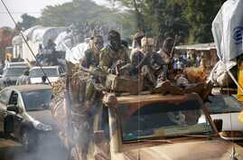 At PK12 Chadian troops escort thousands of Muslim residents from Bangui and Mbaiki, fleeing the Central African Republic capital Bangui in a mass exodus using cars, pickups, trucks, lorries and motorcycles on Friday Feb. 7, 2014.