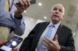 Senate Armed Services Committee Chairman Sen. John McCain, R-Ariz., speaks to reporters on Capitol Hill in Washington, Wednesday, March 8, 2017.