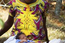 Woman in African dress with baby