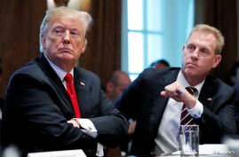 U.S. President Donald Trump listens next to acting U.S. Defense Secretary Patrick Shanahan during a Cabinet meeting on day 12 of the partial U.S. government shutdown at the White House in Washington, Jan. 2, 2019.