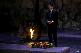 Lithuania's Prime Minister Saulius Skvernelis pays his respects at a ceremony at the Hall of Remembrance at the Yad Vashem Holocaust Memorial in Jerusalem, Tuesday Jan. 29, 2019.